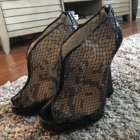 buy online 0f366 6a4a3 Christian Louboutin Janet 120 Python Lace Booties